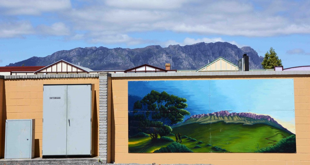 Mural of Mt Roland in Sheffield, Tasmania, With The Real Thing Behind